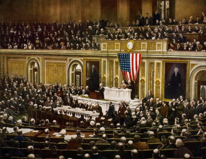 Na današnji dan - Page 14 775px-President_Woodrow_Wilson_asking_Congress_to_declare_war_on_Germany_2_April_1917-696x539